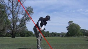 In this photo of one of my professional students, he has taken the club back on plane. If the swing were to continue he would hinge the club up just like his full swing.