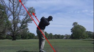 Here the golfer has allowed the club to swing through impact and into his finish as he pivots his body to face the target.