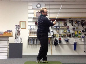In this instance, the clubhead has been allowed to swing, which depending on the desired trajectory, may mean that the hands are not ahead of the golf ball. Let the club swing through the shot, don't try and control the shot by forcing your hands forward.