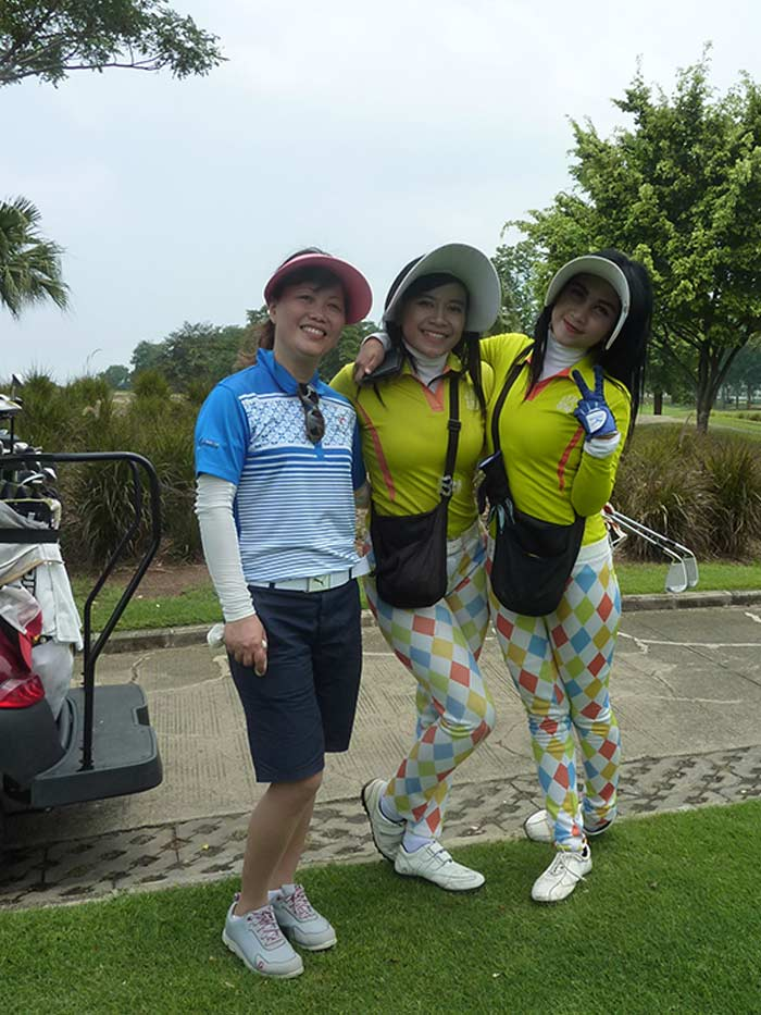 Ms. Vu from Vietnam Golf Magazine and her matching Caddies